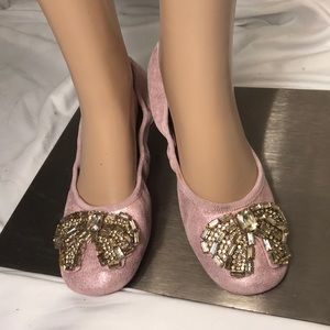 Pink suede coach flats with rhinestone bow